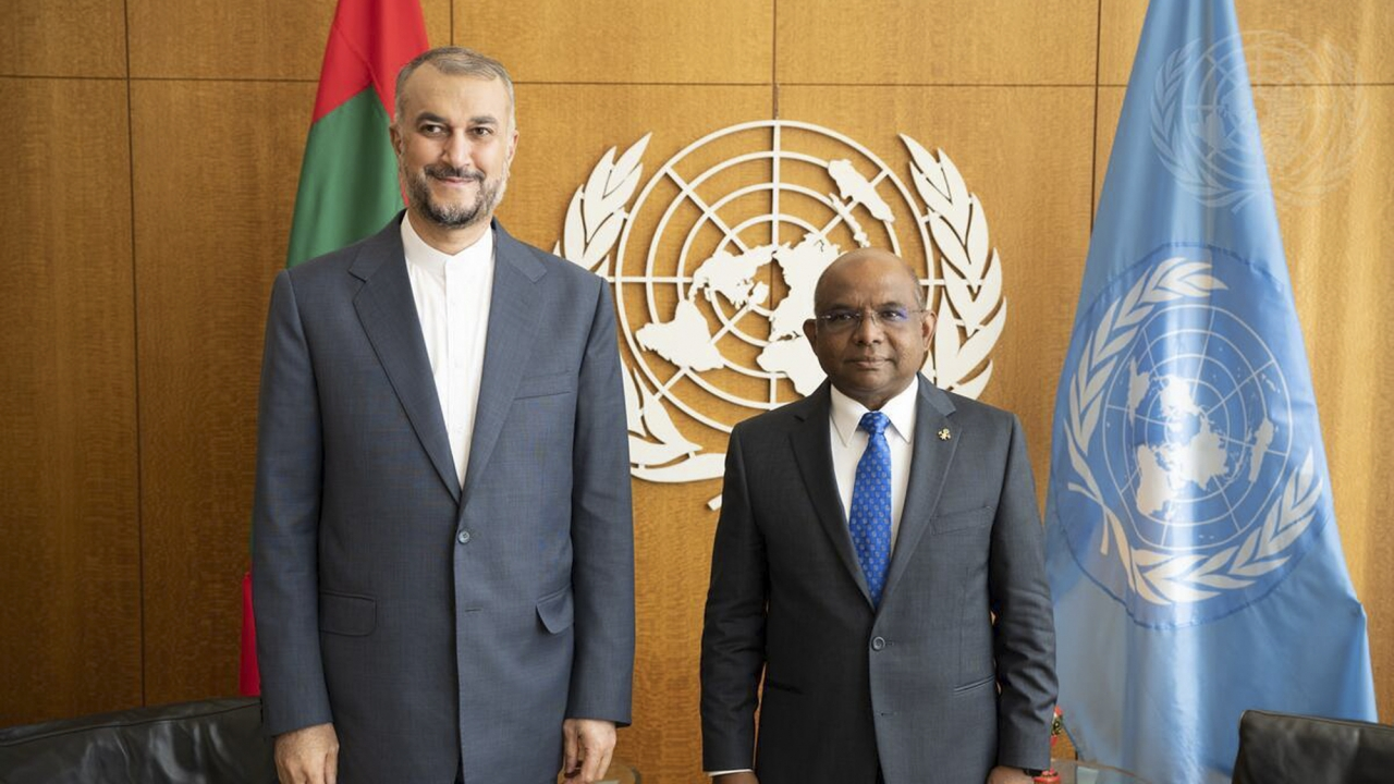UN General Assembly President Abdulla Shahid of Maldives, right, meets with Iran's Foreign Minister Hossain Amir Abdollah