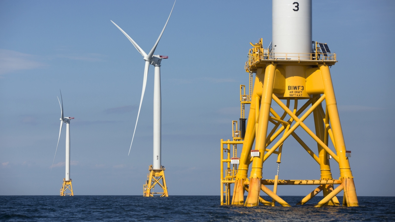 Wind turbines stand in the water