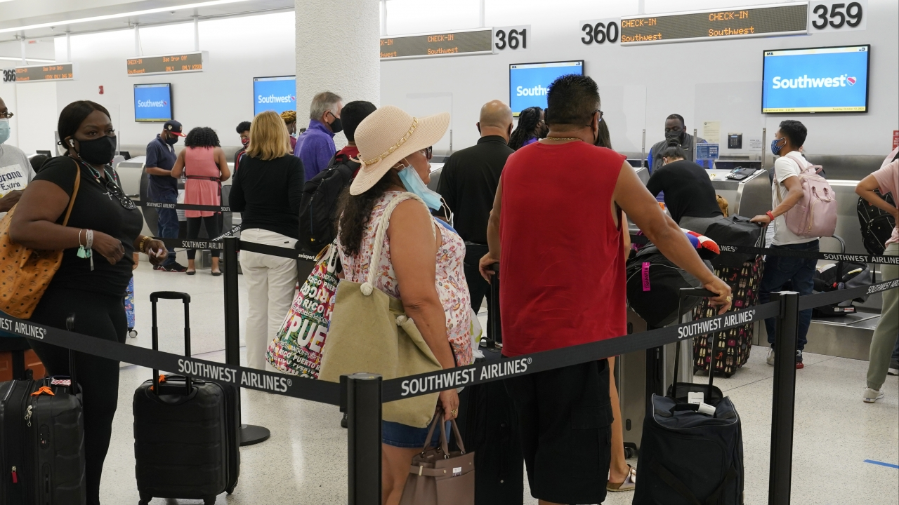 Southwest passengers wait to check in at Miami International Airport, Tuesday, Oct. 12, 2021, in Miami.